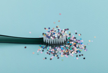 toothbrush with glitter, the concept of dentistry and hygiene