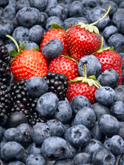 Closeup of strawberries, blackberries and blueberries.
