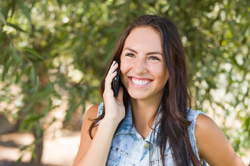 Attractive Happy Mixed Race Young Female Talking on Cell Phone Outside