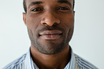 Confident afro americn man standing against white background