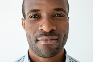 Handsome afro american man standing against white background
