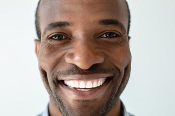 Portrait of optimistic afro american man smiling