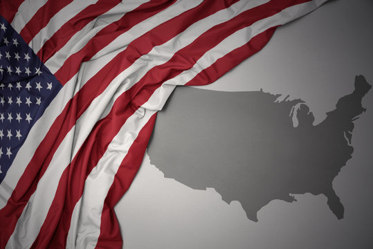 waving colorful national flag and map of united states of america.