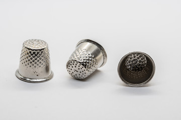 Isolated thimbles on white background. Macro up close shot.