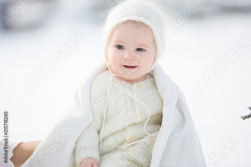 4bf58e50f0b4 Beautiful mother in white dress and cute baby boy in knitted onesie ...