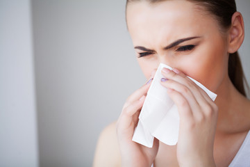 Flu and Sick Woman. Sick Woman Using Paper Tissue, Head Cold Problem Wall mural