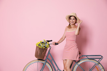 Portrait of beautiful woman with bicycle on color background