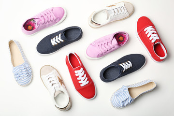 Flat lay composition with stylish new shoes on white background