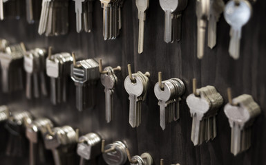 Several Keys type such as household and car key use for copying or duplicating hang on the wall in the locksmith workshop