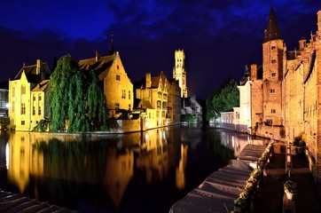 Wall Murals Bridges Evening view of the illuminated medieval canals of Bruges, Belgium