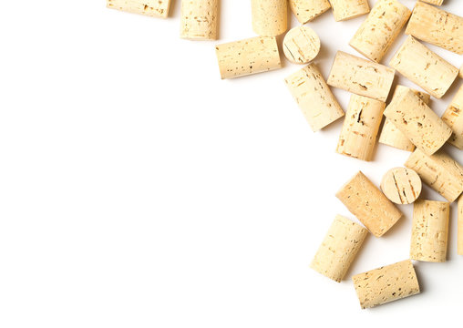 Heap of unused, new, brown natural wine corks on white background, flat lay top view