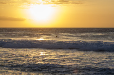 A surfer watching the Sunset