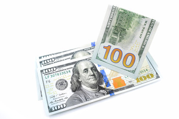 hundred dollar bills on a white background