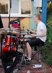 drummer plays drums selective focus