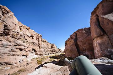 Woman tourist resting in the rocks of San Pedro de Atacama. Chile
