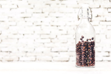 Coffee bean on white wall background