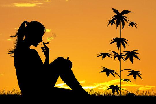 girl smoke marijuana at sunset