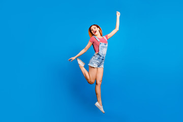 Ha-ha people person concept. Full length size body studio photo portrait of satisfied glad nice sweet lovely with beaming smile girl jumping up raising hands up isolated bright background