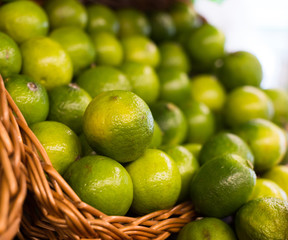 fresh limes in baskets on counter