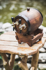 Wooden beer keg with a two tap on table