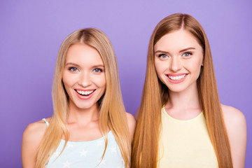 Head shot portrait of cheerful positive girls with white healthy smile having long hair looking at camera isolated on violet background. Dental dentist stomatology concept