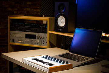 music keyboard and professional recording equipment in sound studio