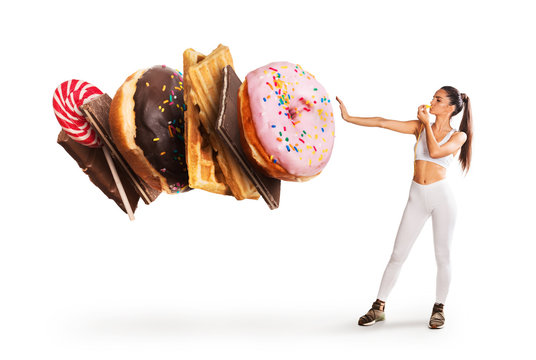 Fit young woman saying NO to sweets