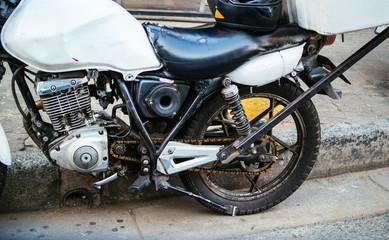Old motorcycle and helmet