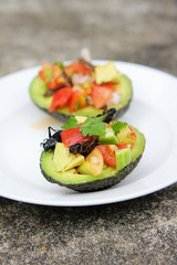 Cricket Ceviche served in an Avocado