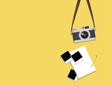 hanging old vintage camera with photos on a yellow background