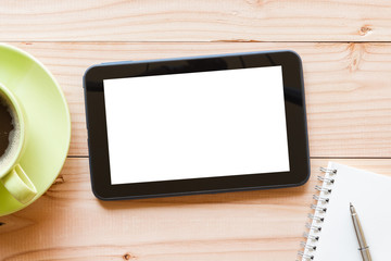 tablet computer with blank white screen on wooden background