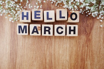 march alphabet letters on wooden background