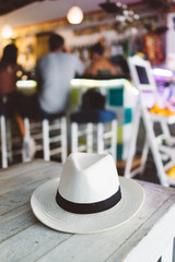 White hat on the wooden table