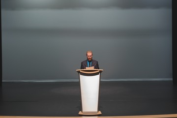Man practicing his speech on stage