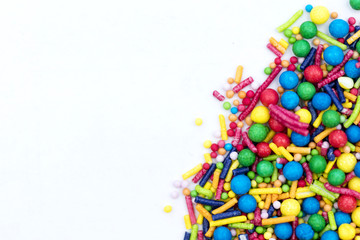 Colourful candy cake decorative sprinkles background