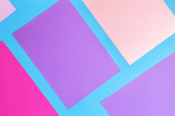 Color papers geometry flat composition background with pink, purple, violet yellow and blue tones