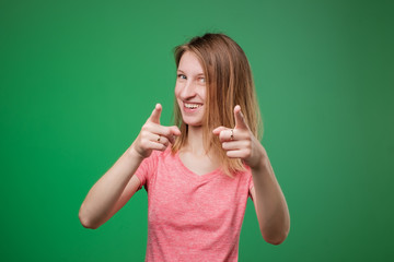 Portrait of a confident young european woman pointing finger at camera