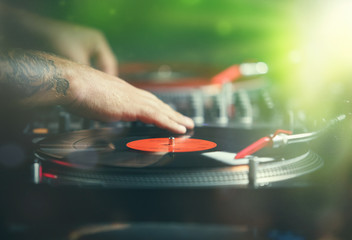 hip hop dj scratches vinyl records with music