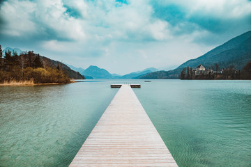 Wooden pier at Lake Fuschlsee in summer, Salzburg, Austria