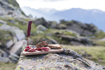 bacon on wood plate on a mountain in south tyrol