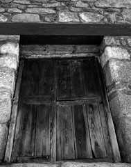 european,europe,no people,low angle view,brick,window,door,wooden,wood,ancient,old,traditional,rural,rustic,grey,gray,stones,stone,rocks,close up,details,black and wite,warehouse,farmhouse,village,cou