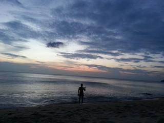 Man making photo of sunset to mobile, Phuket, Thailand