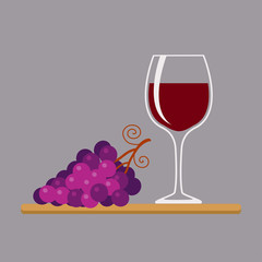 Wine glass and grapes, isolated on gray background