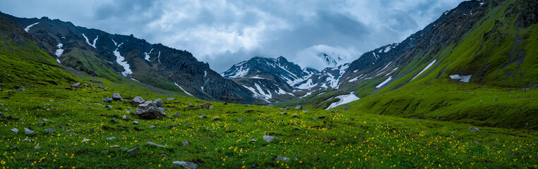 Panorama with peaks and glacier