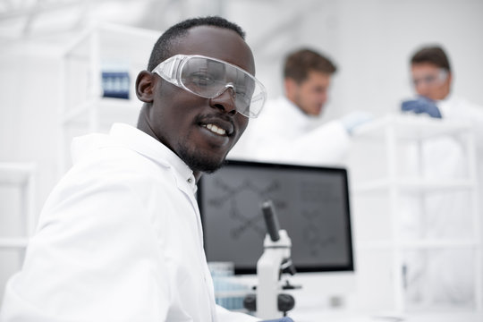 close up.modern scientist at the laboratory table
