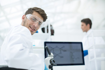 close up.a young scientist in a modern laboratory