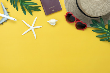Table top view aerial image of fashion to travel in summer holiday background.Flat lay accessories clothing for traveler.Passport sunglasses on modern rustic yellow paper wallpaper.Space for content.