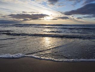 Beautiful sunset on the sandy beach of the Baltic Sea in Lietva, Klaipeda