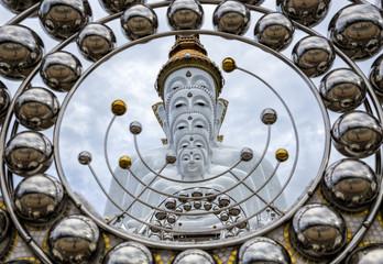 White Buddha Statue at Wat Prathat Phasornkaew Thailand
