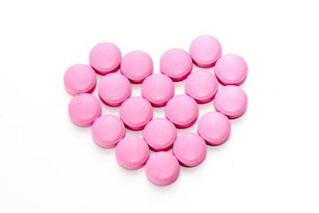 Heart of pink pills.